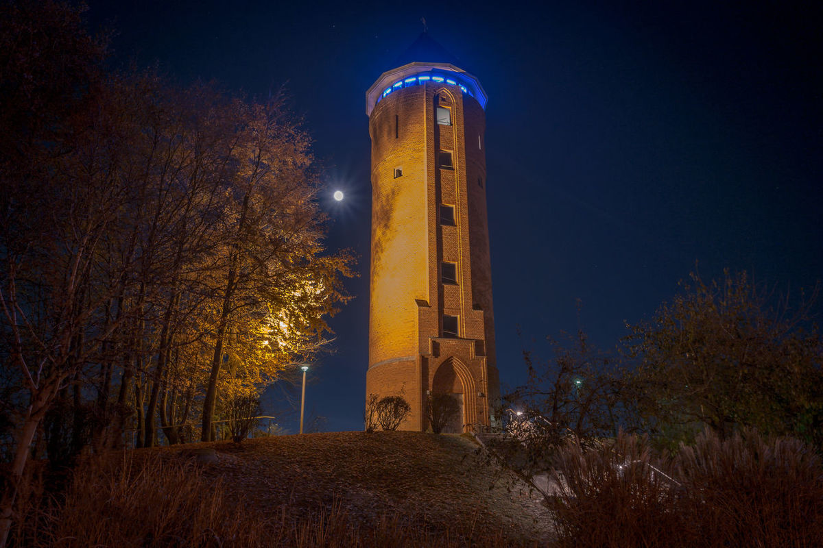 Alter Wasserturm mit Super-Mond Architecture City Cityscape Grimmen Illuminated Long Exposure Low Angle View Midnight Night No People Old Buildings Outdoors Sky Super Moon Tourism Tower Travel Destinations Tree Water Tower
