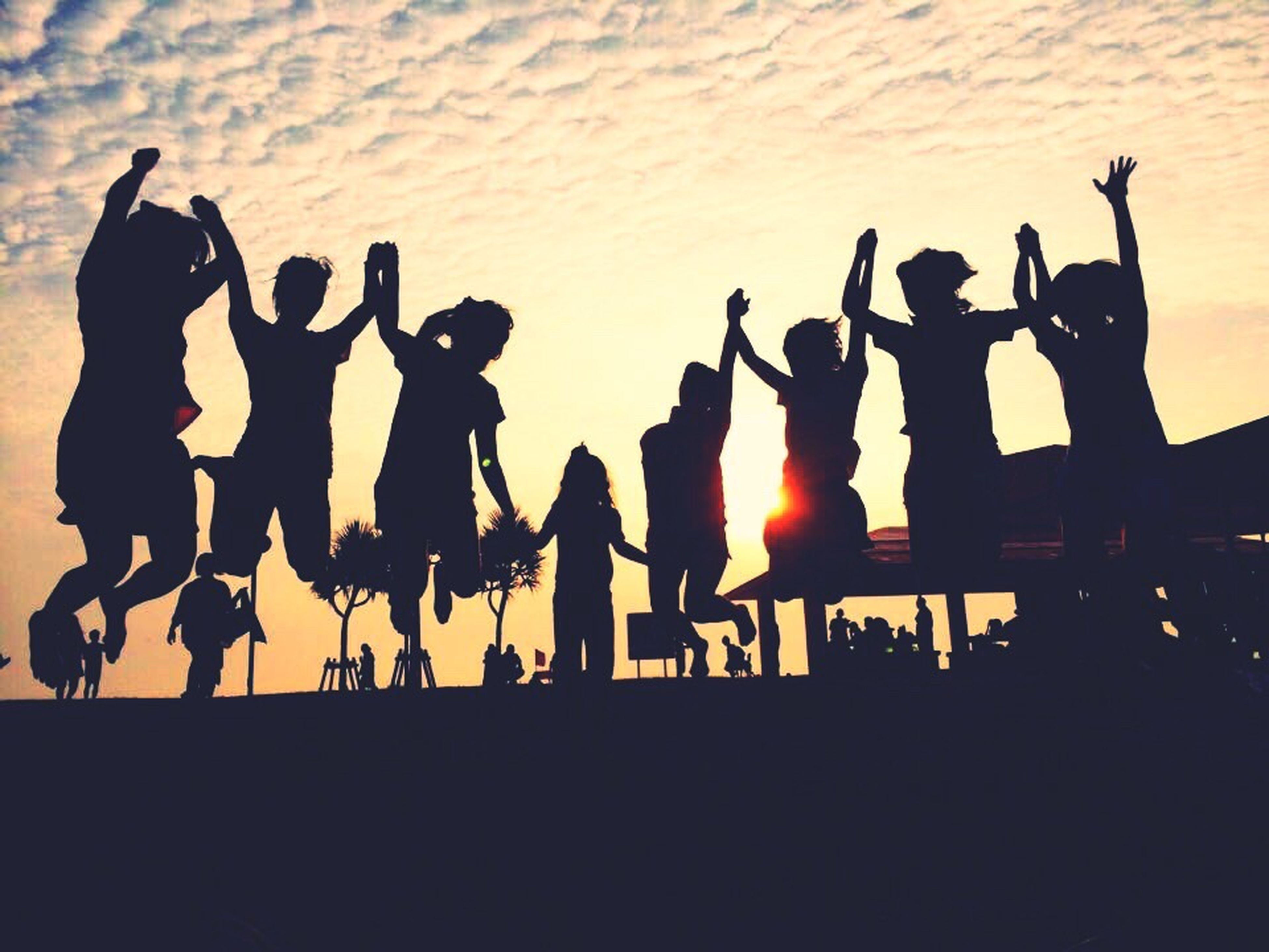 sunset, lifestyles, leisure activity, outdoors, orange color, outline, medium group of people, sky, side by side, enjoyment, sun, tourism