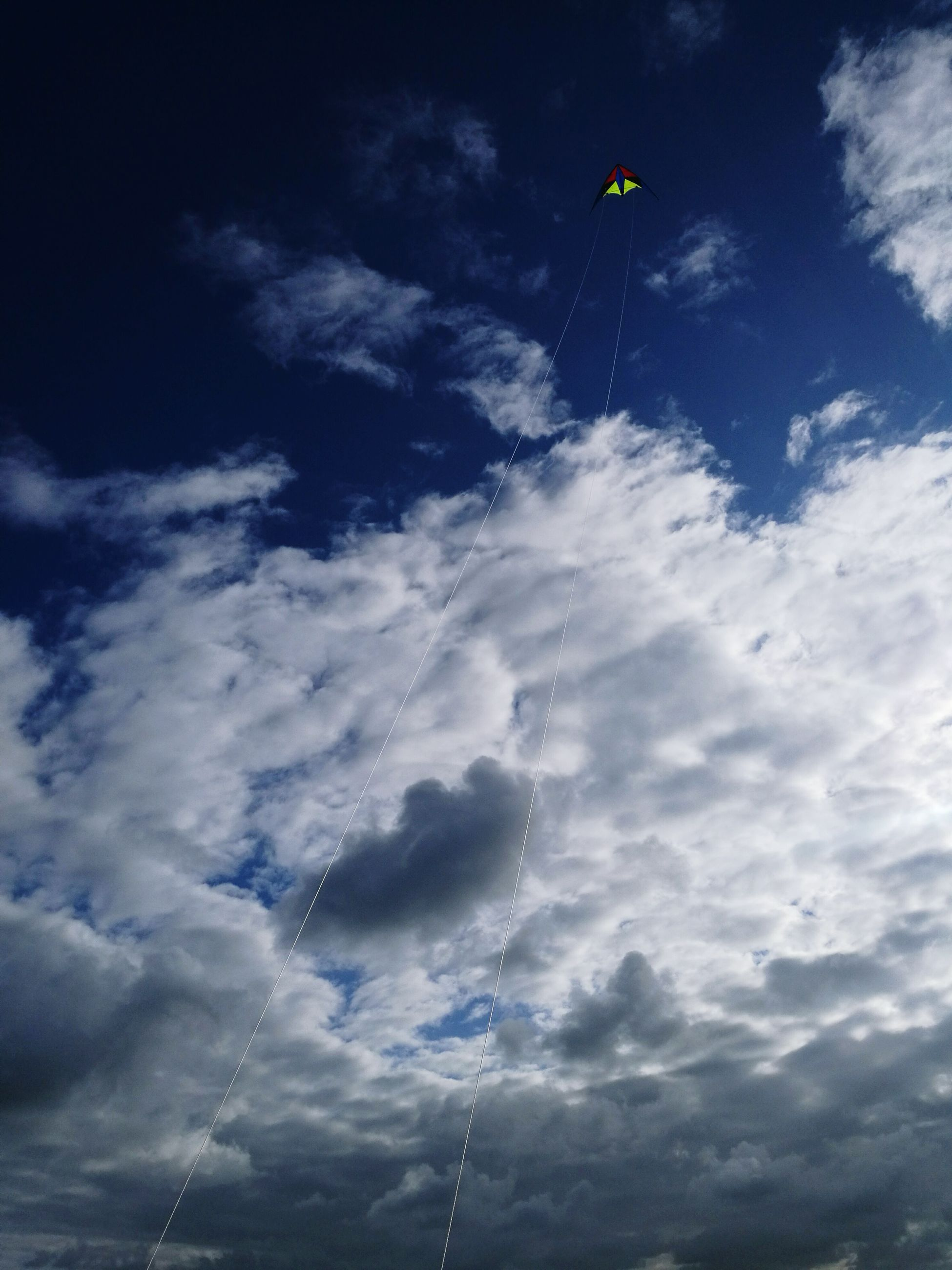 low angle view, sky, beauty in nature, cloud - sky, tranquility, nature, flying, cloud, blue, scenics, tranquil scene, day, outdoors, cloudy, cloudscape, full frame, multi colored, no people