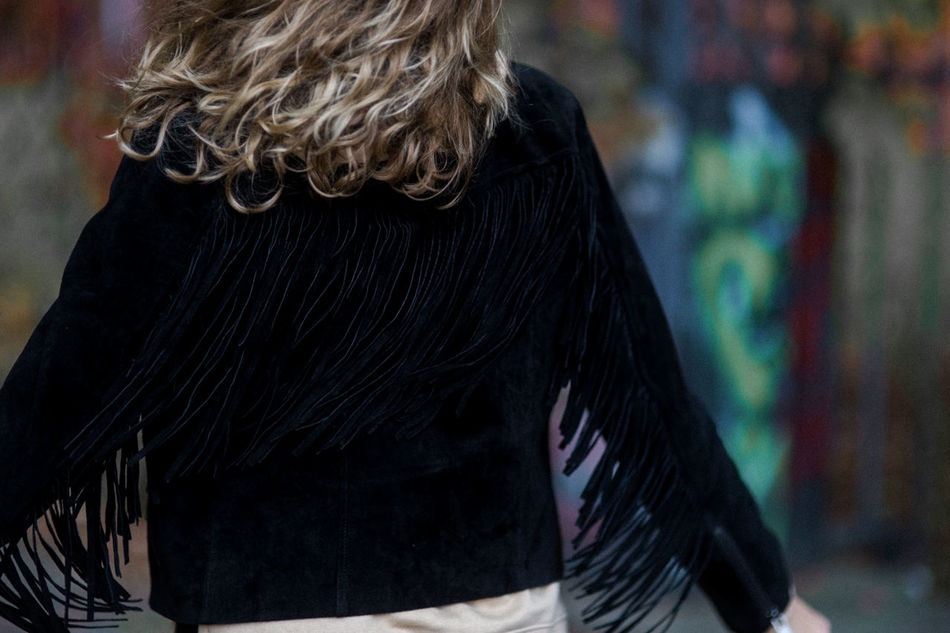 Arms Outstretched Close-up Curly Hair Day Fashion Focus On Foreground Fringes From The Back Happiness One Person Outdoors People Real People Rear View Warm Clothing