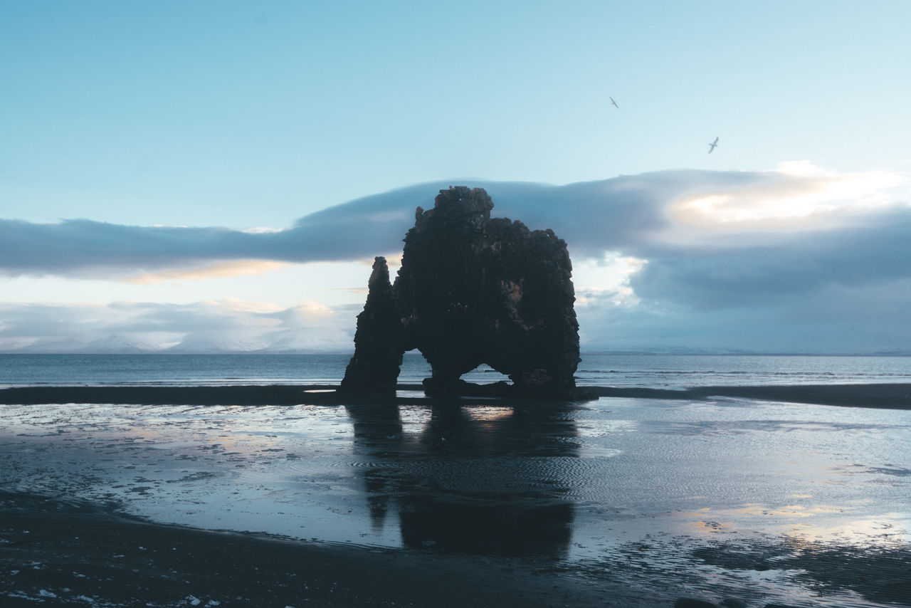 Rock formation in iceland on a black sand beach Beach Beauty In Nature Day Full Length Horizon Over Water Lifestyles Men Nature One Person Outdoors People Real People Rock - Object Scenics Sea Silhouette Sky Sunset Tranquil Scene Tranquility Water