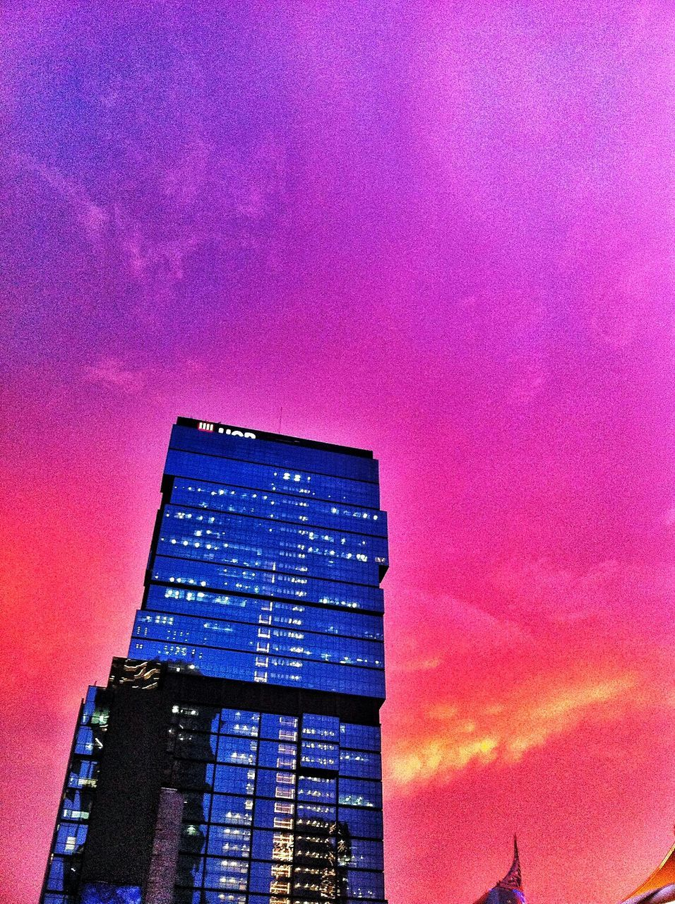 architecture, built structure, purple, building exterior, low angle view, sunset, pink color, modern, skyscraper, sky, no people, illuminated, outdoors, city, day