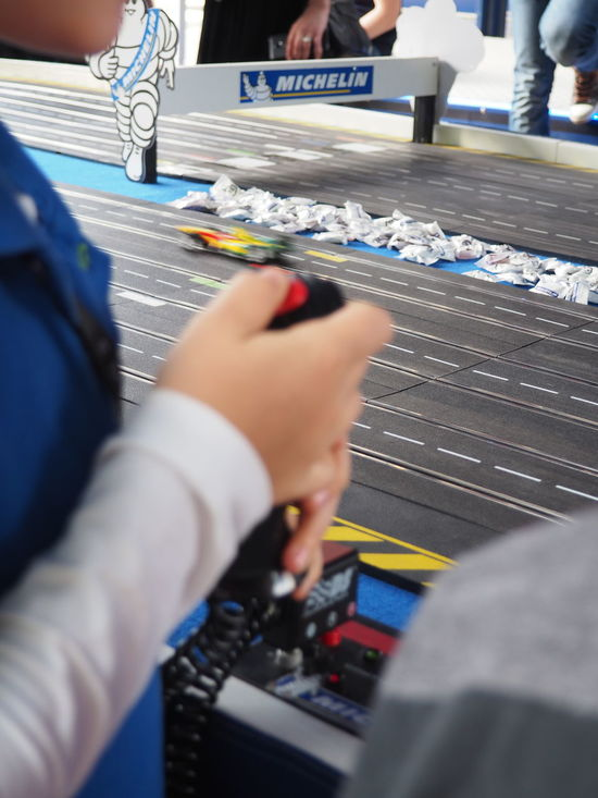Cars Childhood Close-up Competition Electric Cars F1 Fast Faster Formula E Fun Game Human Hand Joystick Kid Playing Race Racing Racing Car Railing Real People Retro Future Speed