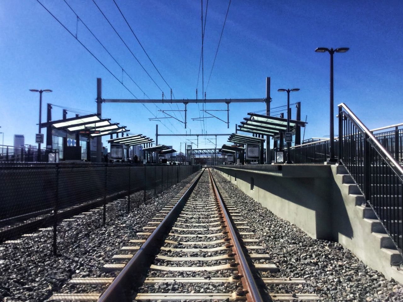 Cable Clear Sky Connection Day Electricity  Electricity Pylon No People Outdoors Public Transportation Rail Transportation Railroad Tie Railroad Track Railway Signal Railway Track Sky The Way Forward Transportation