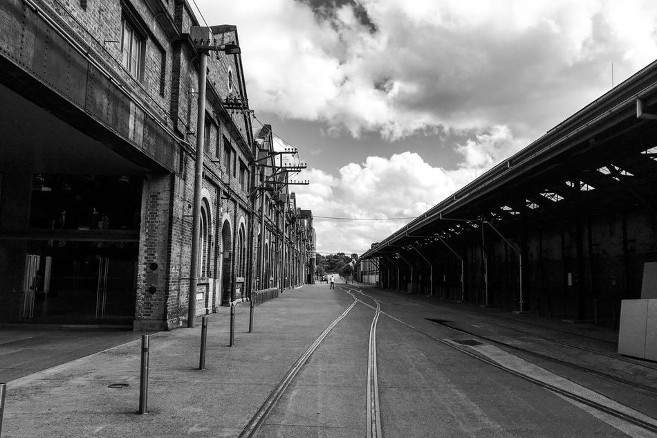 Built Structure Sky Architecture Building Exterior The Way Forward Shadows & Lights Monochrome Day Outdoors Railroad Station City Cloud - Sky No People Road Railroad Station Platform