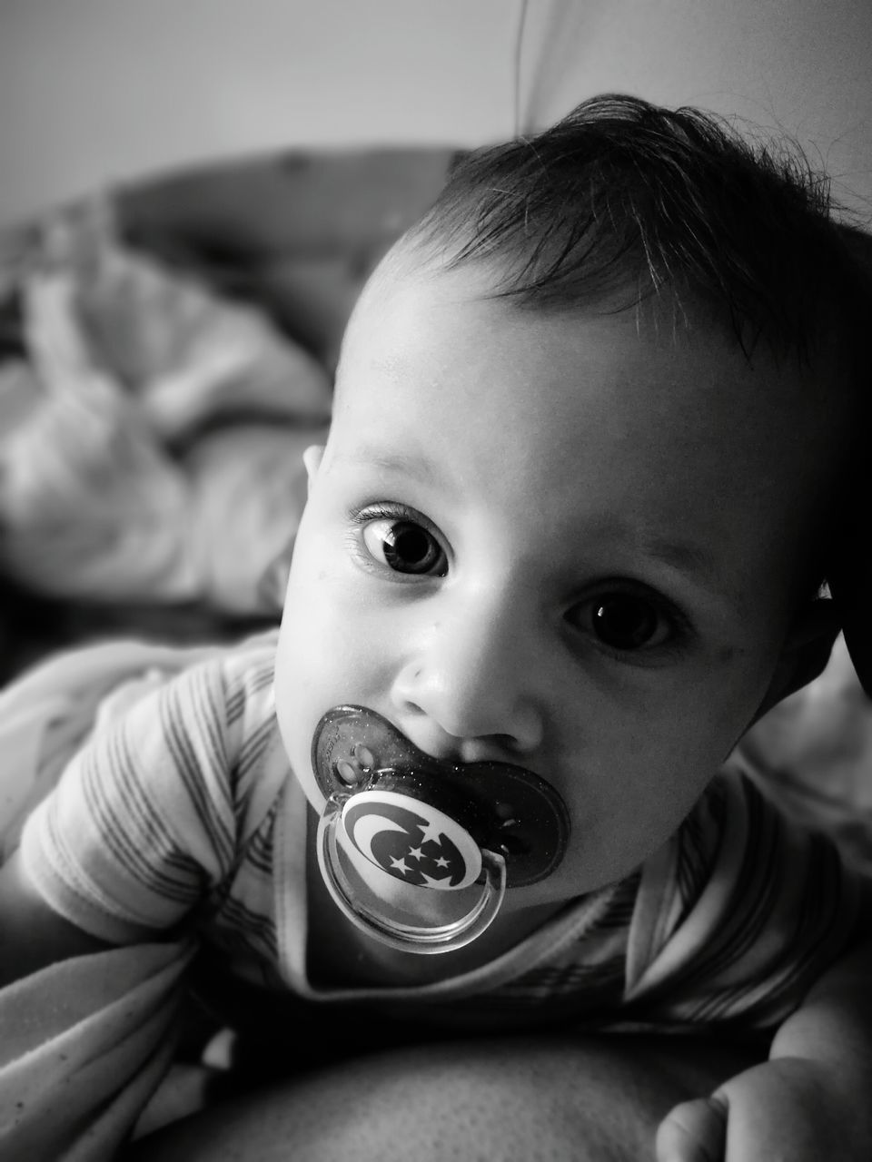 baby, innocence, childhood, babyhood, indoors, cute, one person, real people, pacifier, looking at camera, babies only, home interior, bed, portrait, close-up, day, people