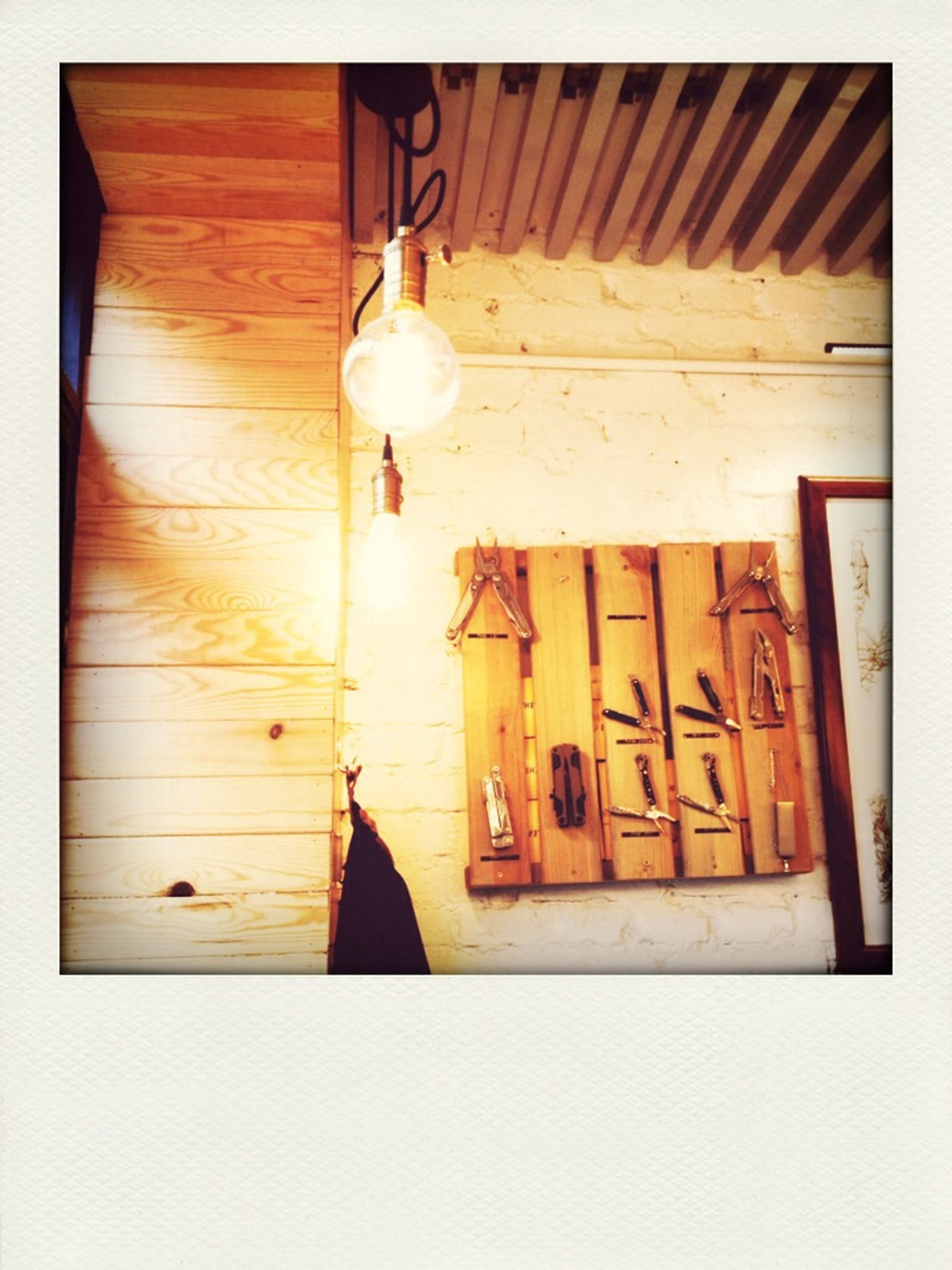 transfer print, indoors, auto post production filter, wood - material, wooden, table, still life, wood, close-up, no people, hanging, wall, home interior, shelf, wall - building feature, in a row, door, shadow, old, old-fashioned