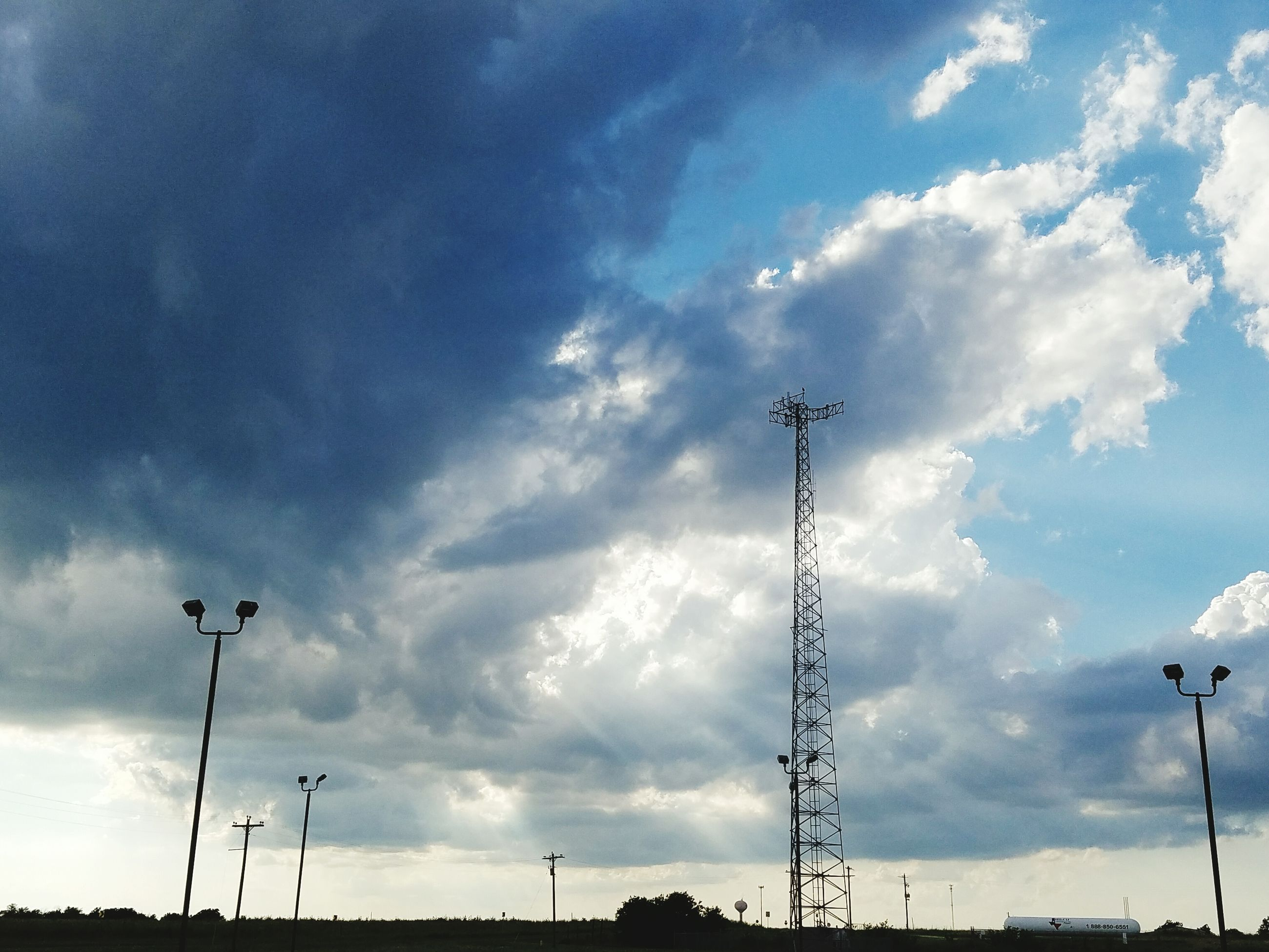 sky, low angle view, cloud - sky, electricity, cloudy, power line, electricity pylon, technology, fuel and power generation, street light, power supply, cloud, connection, silhouette, lighting equipment, cable, nature, tranquility, outdoors, pole