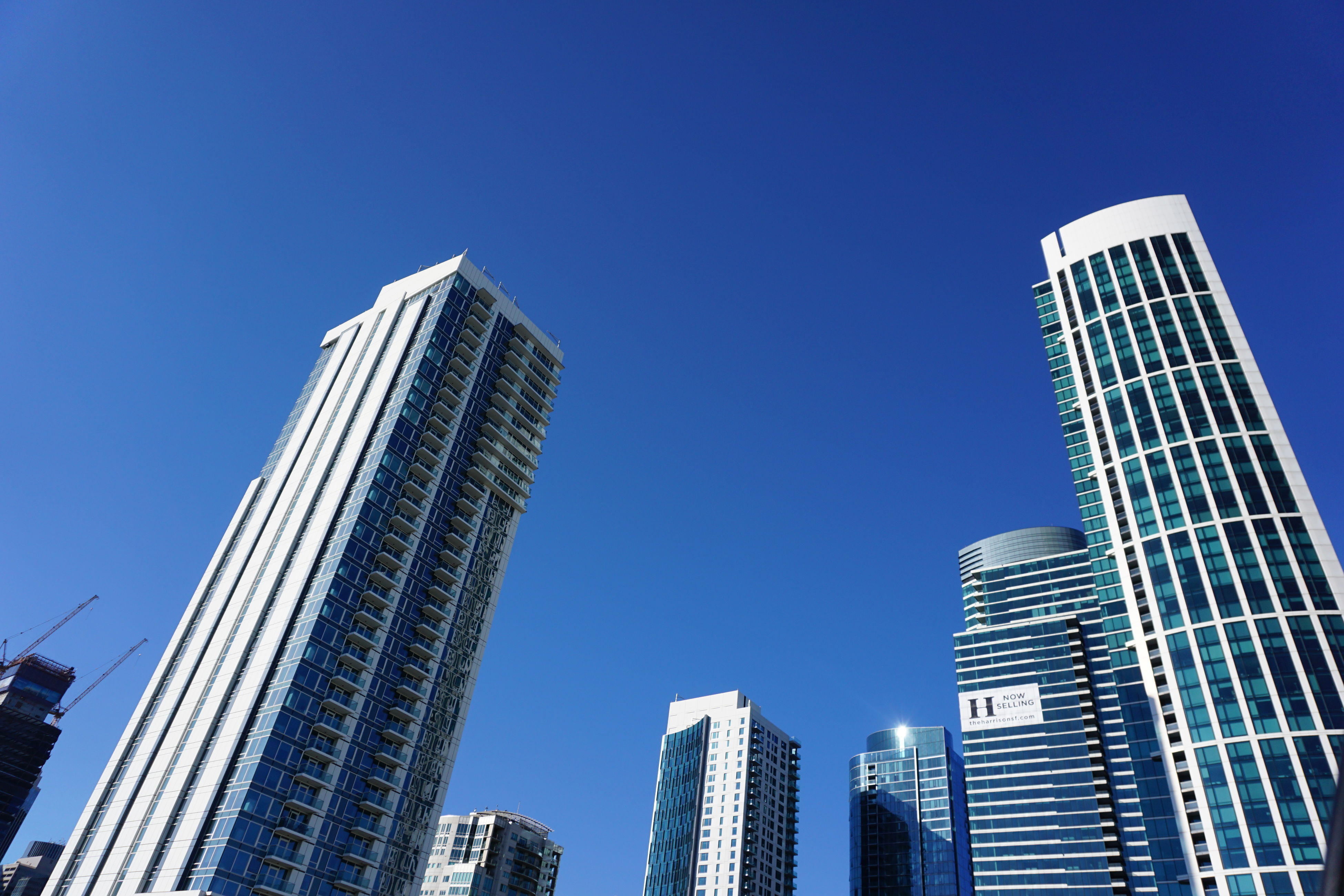 skyscraper, architecture, low angle view, building exterior, tall - high, built structure, modern, city, clear sky, office building, tower, blue, tall, development, financial district, day, outdoors, downtown district, no people, travel destinations, growth, urban skyline, sky, office park