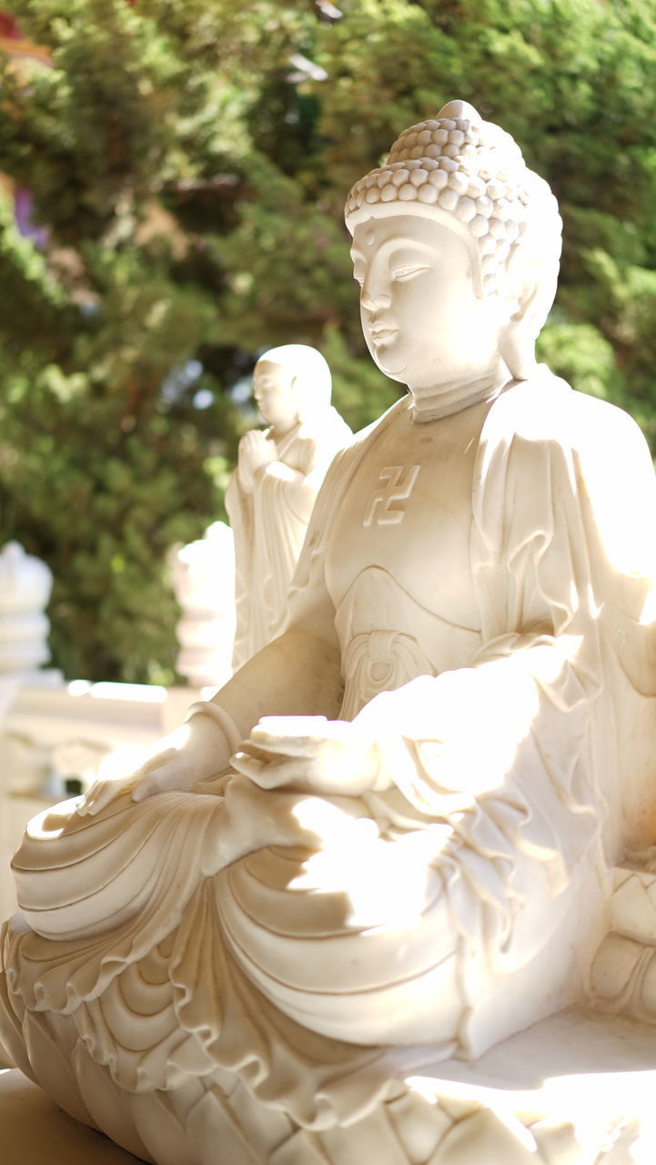 Close-Up Of Buddha Statue At Temple