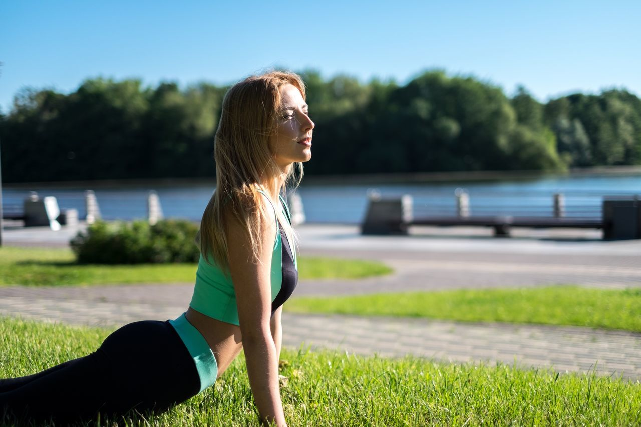 Woman training in the park Real People One Person Outdoors Leisure Activity Training Time Workout Females Copy Space