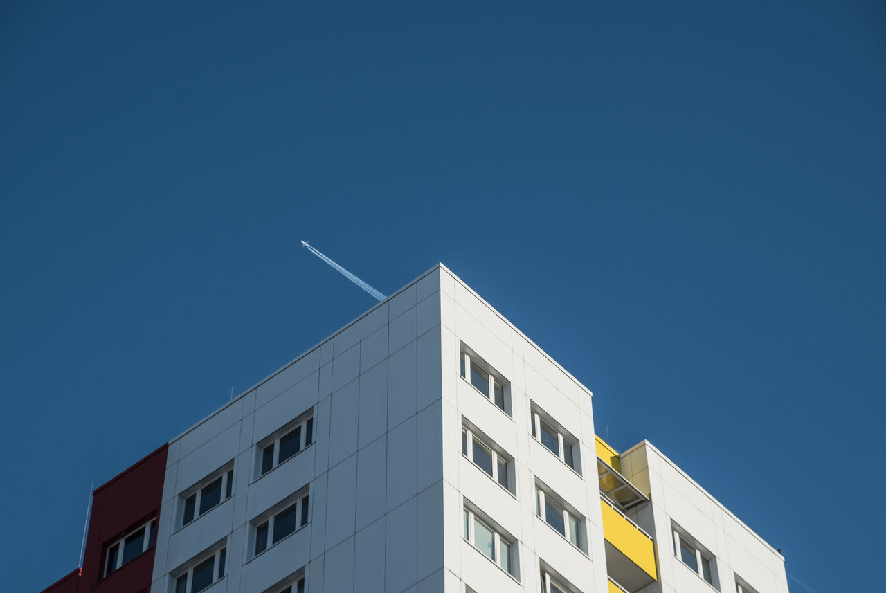 Buildingvaportrailagain Airplane Architectural Detail Architectural Feature Architecture_collection Berlin Berlin Photography Berliner Ansichten Blue Building Building Exterior Built Structure City Life Cityscape Day Lookingup Low Angle View Modern No People Outdoors Residential Building Sky Urban Skyline Urbanphotography Vapor Trail