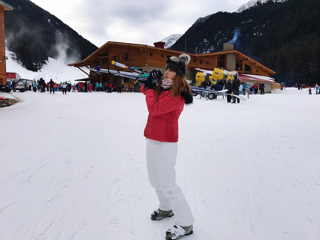 Woman Holding Ski Skiing Real People Winter Snow Lifestyles Cold Temperature Leisure Activity Sky Weather Rear View Outdoors Warm Clothing One Person Day Nature Full Length Women Building Exterior Architecture Mountain Men