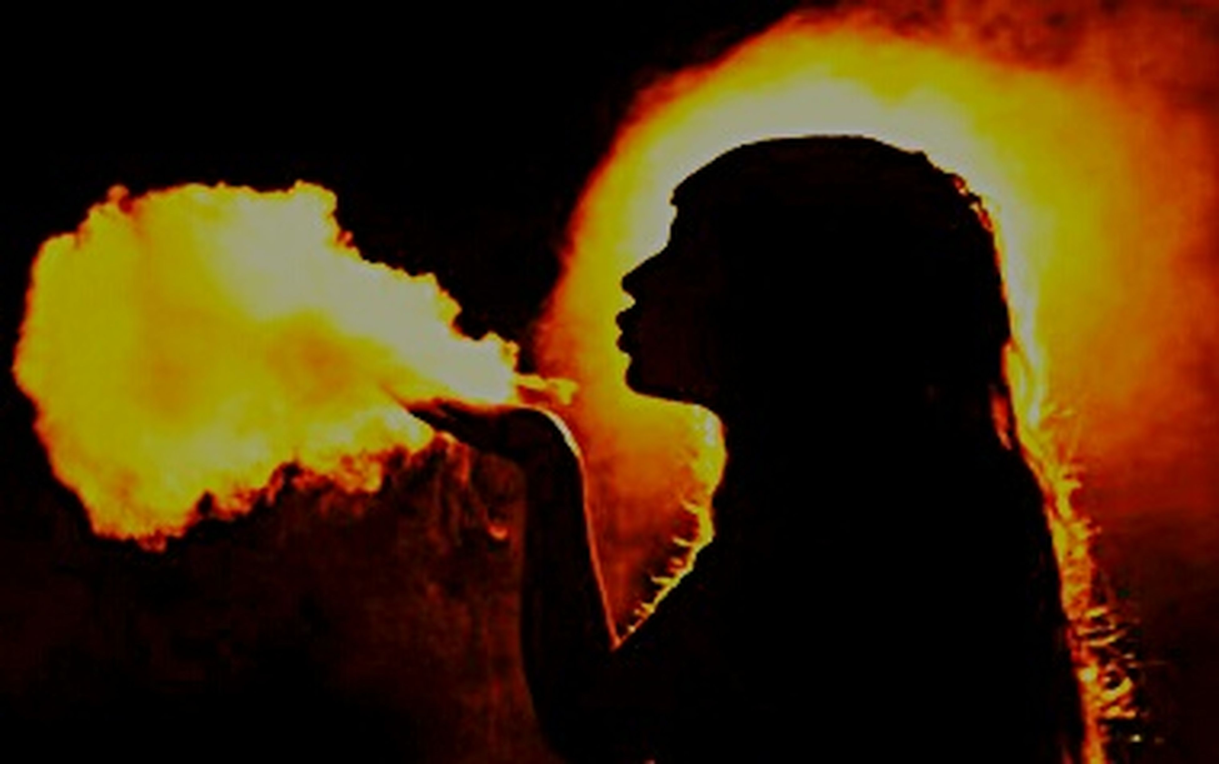 silhouette, headshot, adults only, black background, flame, young adult, smoke - physical structure, one person, burning, heat - temperature, people, one man only, adult, only men, outdoors, night, illuminated, human body part, close-up