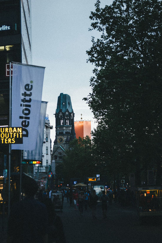 Architecture Building Exterior Built Structure Car City City Life Communication Crowd Day Gedächtniskirche Illuminated Land Vehicle Large Group Of People Men Outdoors People Real People Road Road Sign Sky Text Tree Urban Outfitters