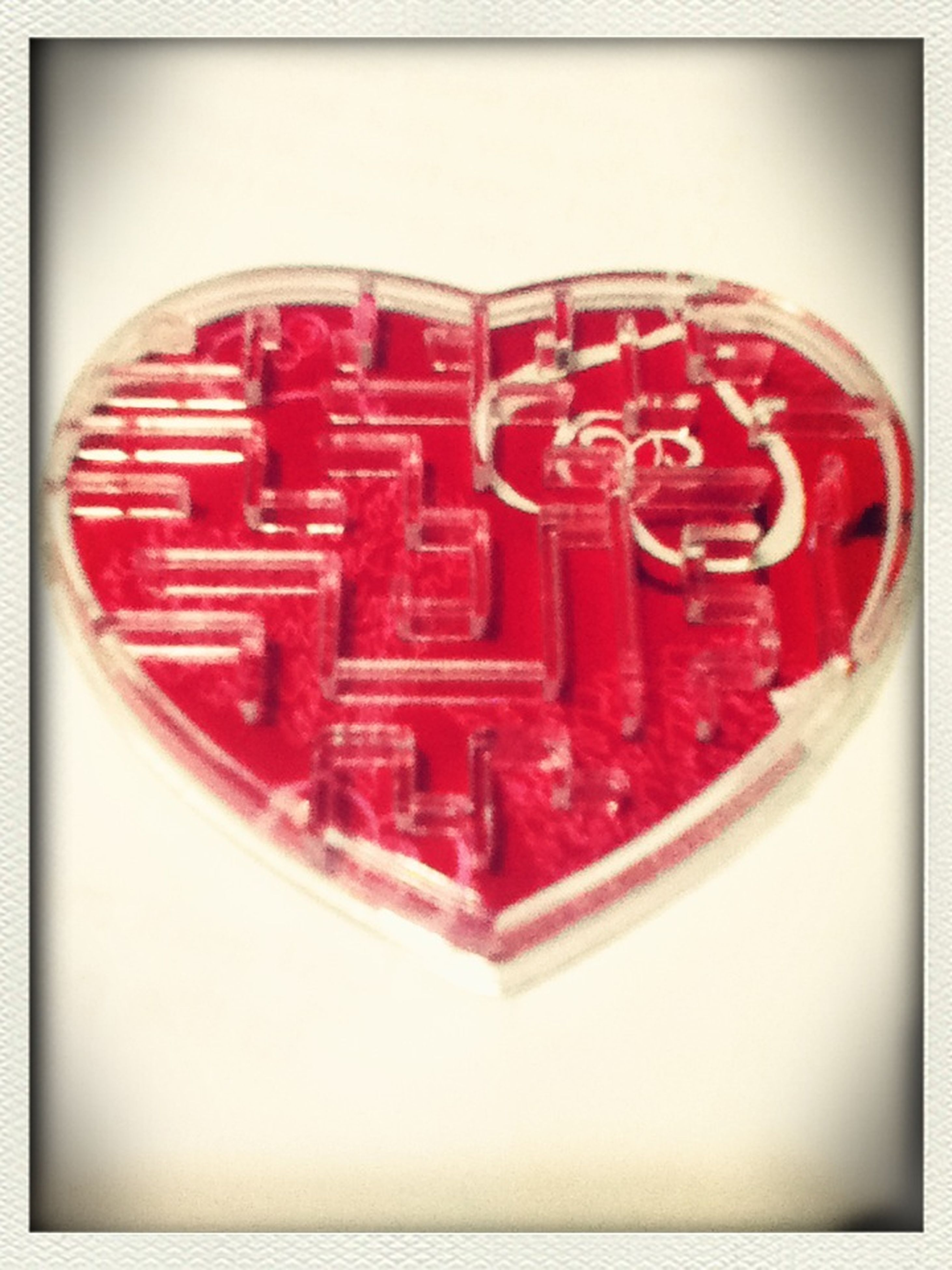 transfer print, red, auto post production filter, indoors, close-up, circle, still life, single object, high angle view, heart shape, no people, studio shot, directly above, geometric shape, love, communication, shape, metal, food and drink, vignette