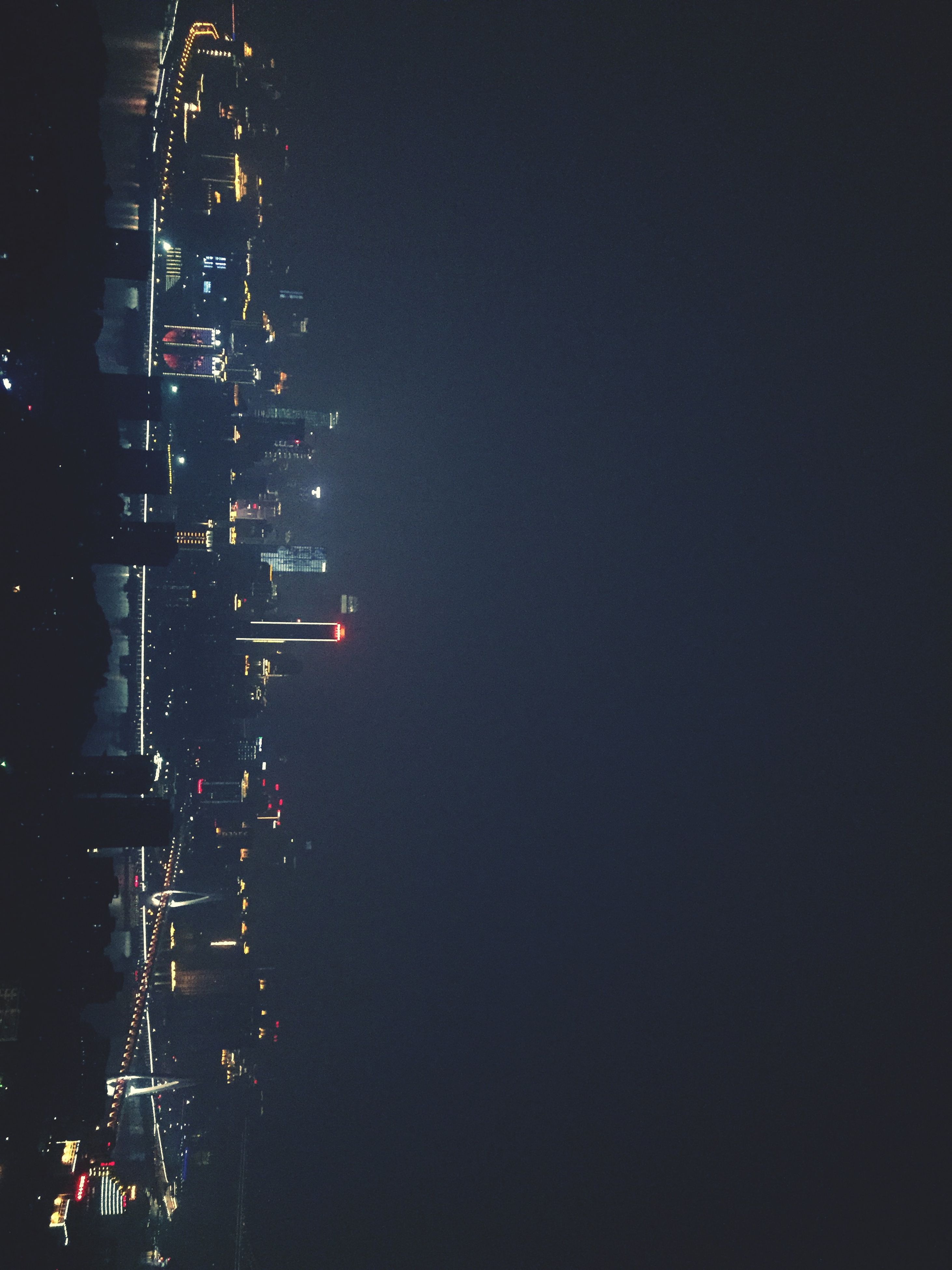 night, illuminated, building exterior, city, architecture, built structure, cityscape, skyscraper, tall - high, tower, modern, office building, sky, city life, copy space, urban skyline, clear sky, residential building, outdoors, light - natural phenomenon