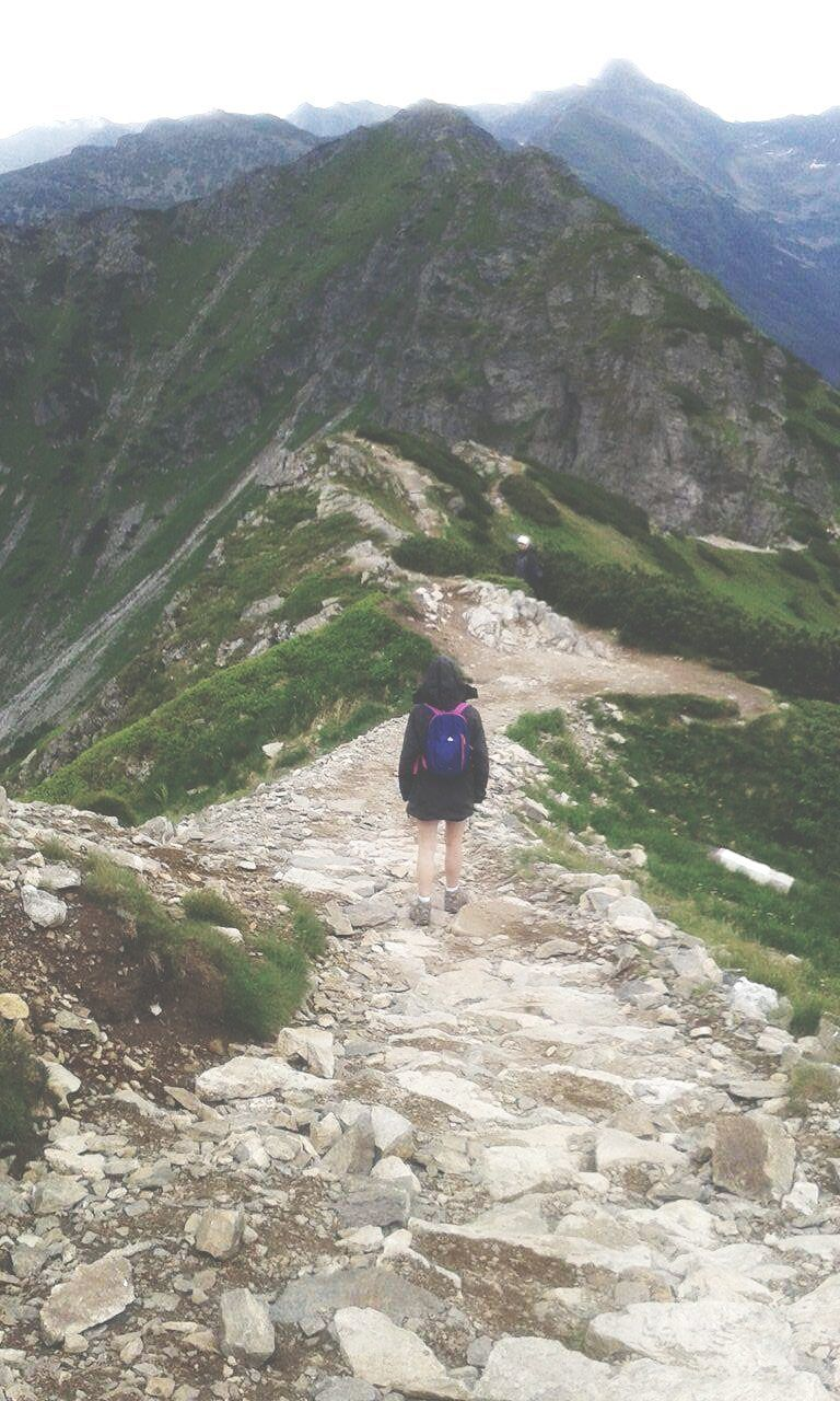 mountain, rear view, real people, walking, one person, full length, nature, lifestyles, adventure, day, beauty in nature, leisure activity, outdoors, mountain range, scenics, men, sky, people
