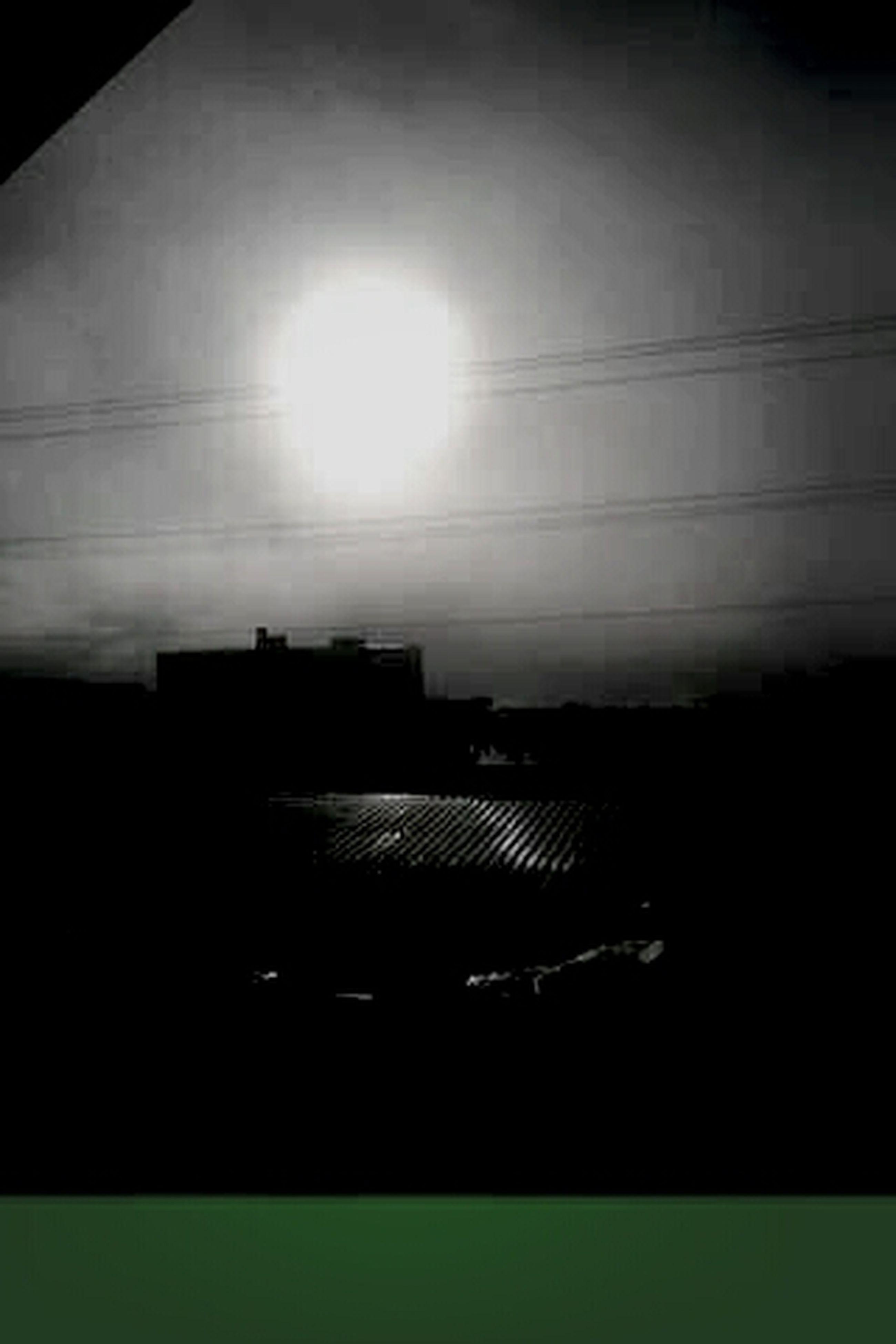 built structure, architecture, building exterior, sky, silhouette, low angle view, window, sun, dark, building, sunlight, power line, no people, outdoors, sunset, cloud - sky, dusk, auto post production filter, nature, city