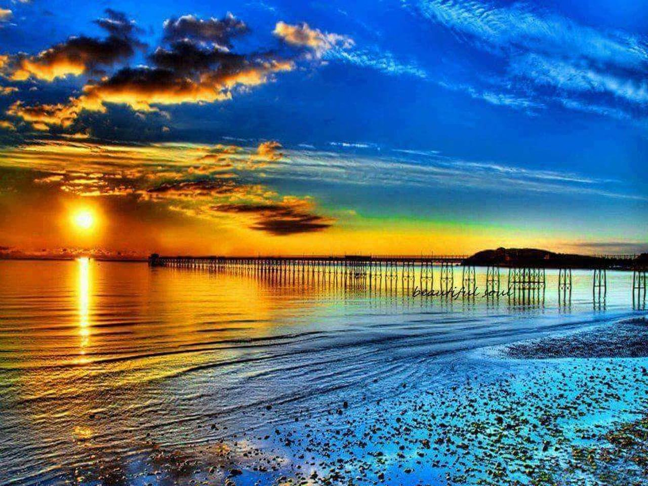sunset, scenics, beauty in nature, sea, tranquil scene, water, sky, reflection, nature, blue, cloud - sky, tranquility, beach, idyllic, outdoors, no people, awe, travel destinations, horizon over water, day