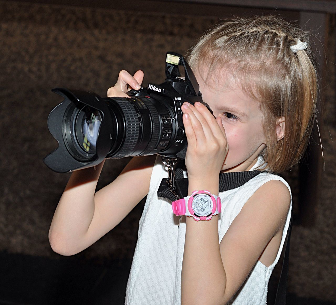 camera - photographic equipment, girls, photography themes, childhood, blond hair, one person, photographing, digital camera, child, technology, arts culture and entertainment, portrait, real people, children only, digital single-lens reflex camera, movie camera, outdoors, close-up, day, people