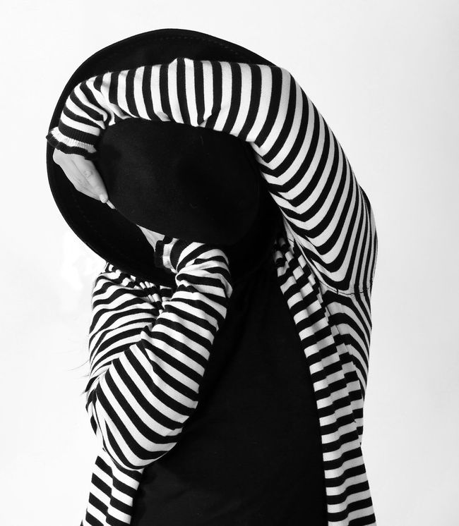 Black And White Black Hat Curling Curves And Lines Day Hands Hat Indoors  Lines And Shapes One Person Person Portrait Portrait Of A Woman Portraiture Real People Standing White Background Young Adult