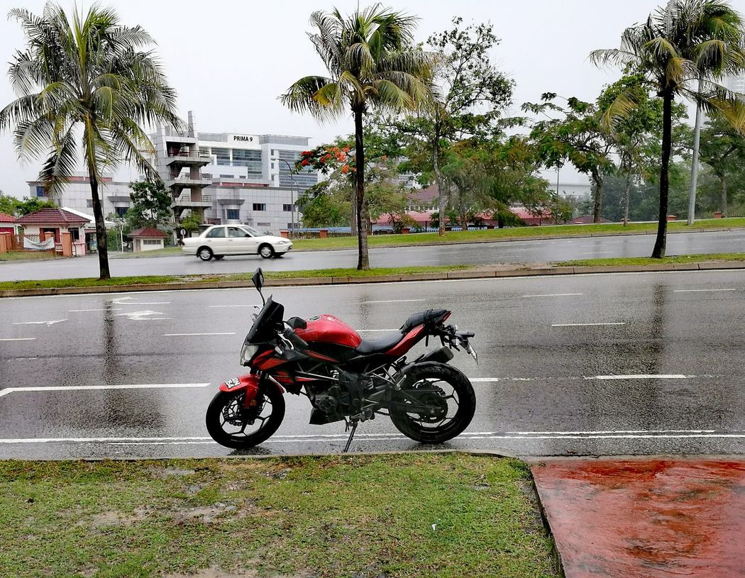 Raining day. Motorcycle Z250sl Safety First