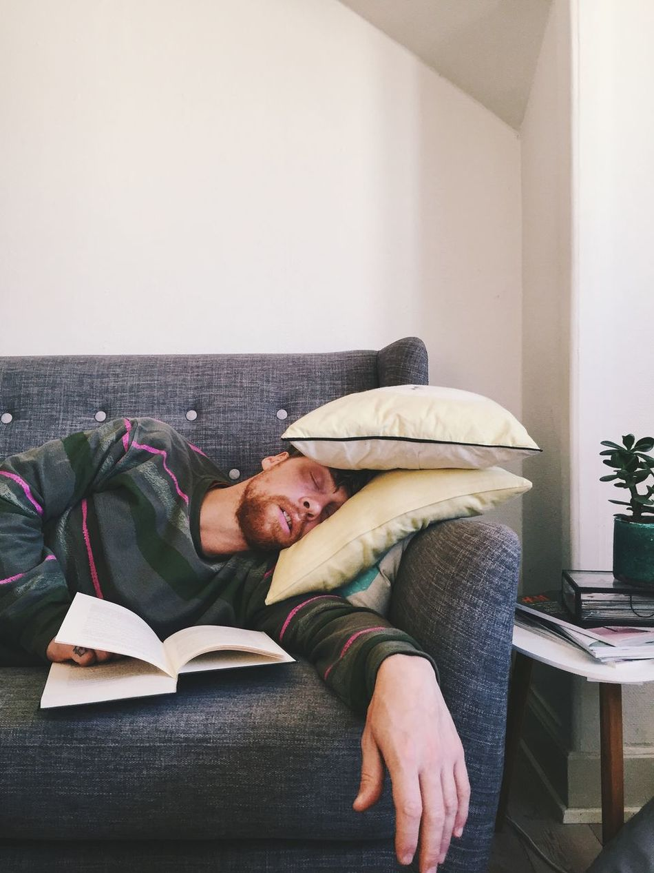 Adult life... Lifestyles One Person Sofa Casual Clothing Leisure Activity Real People Relaxation Couch Indoors  Men Multitasking Reading A Book Sleeping Sleeping Beauty