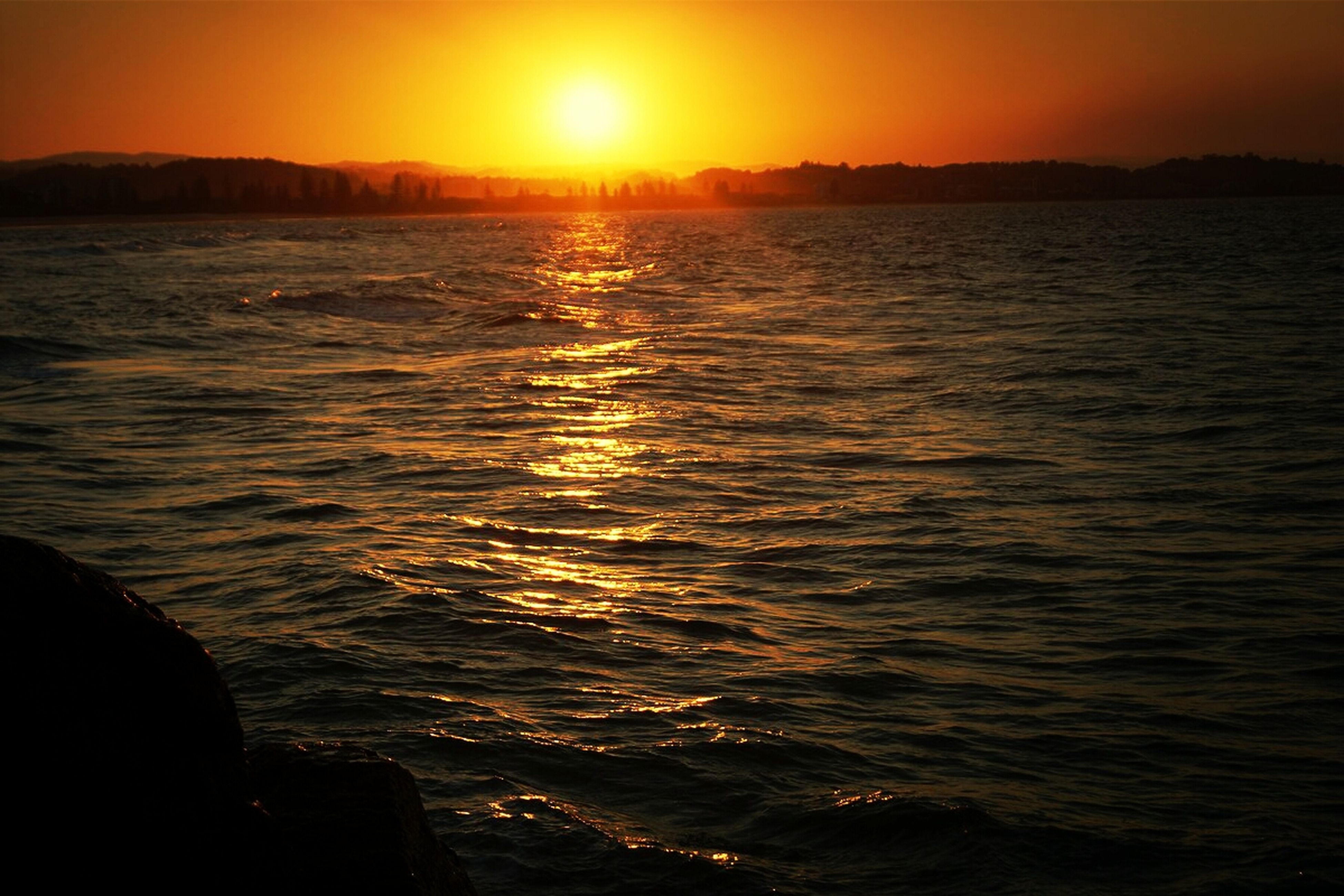 sunset, sun, water, scenics, orange color, tranquil scene, beauty in nature, tranquility, sea, reflection, silhouette, idyllic, sunlight, nature, sky, rippled, waterfront, sunbeam, lens flare, mountain