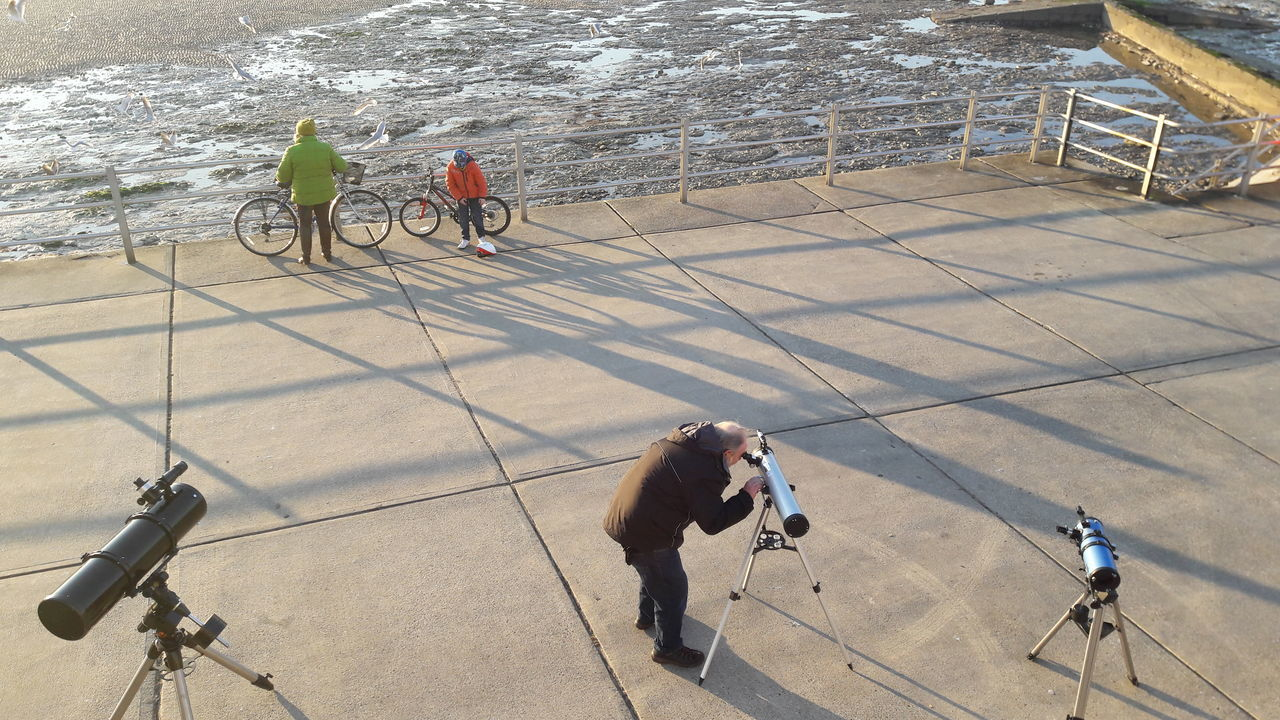 Astronomy Outdoors Real People People Leisure Activity Telescopes Bycicles Sky Seascape Photography Shadows & Lights