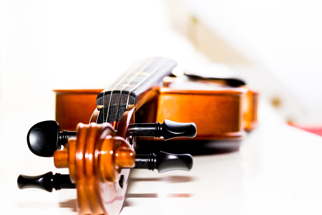 This is a studio shot of a violin i have been working with, I have been working on bokeh and different depths of field. Arts Culture And Entertainment Black Color Bokeh Classical Music Day EyeEm Gallery Fretboard Guitar Hi-key Indoors  Music Musical Equipment Musical Instrument Musical Instrument String No People Shallow Depth Of Field String Instrument Strings Studio Shot This Week On Eye Em Violin White White Background Wood