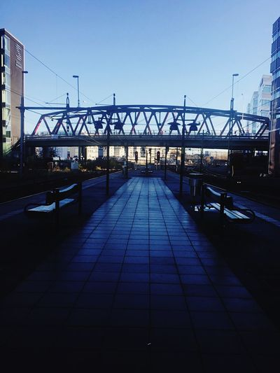 From darkness to light. Sunny Day Commuting Bridge Train Station Station