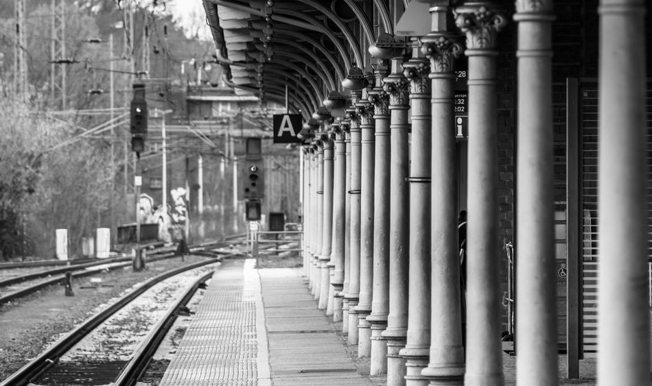 Architectural Column Architecture Black & White Built Structure Day EyeEm Gallery In A Row No People Outdoors Pillars Rail Transportation Railroad Station Railroad Track Rails Row S-bahnhof Schienen Signal Subway Station The Way Forward Transportation