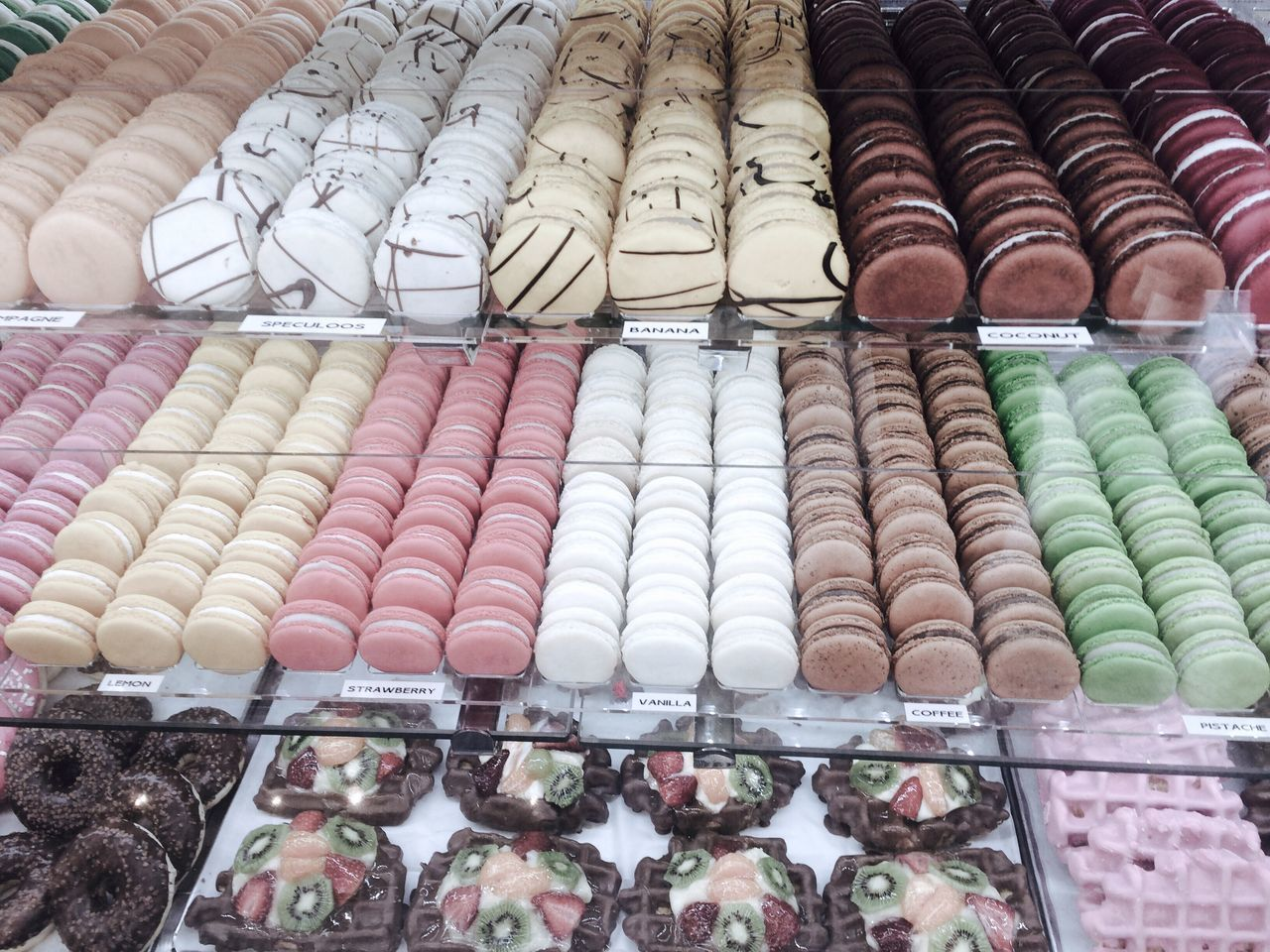 variation, large group of objects, choice, in a row, arrangement, for sale, sweet food, retail, multi colored, macaroon, food and drink, abundance, food, no people, indulgence, temptation, indoors, dessert, collection, unhealthy eating, candy, day, freshness, ready-to-eat, close-up