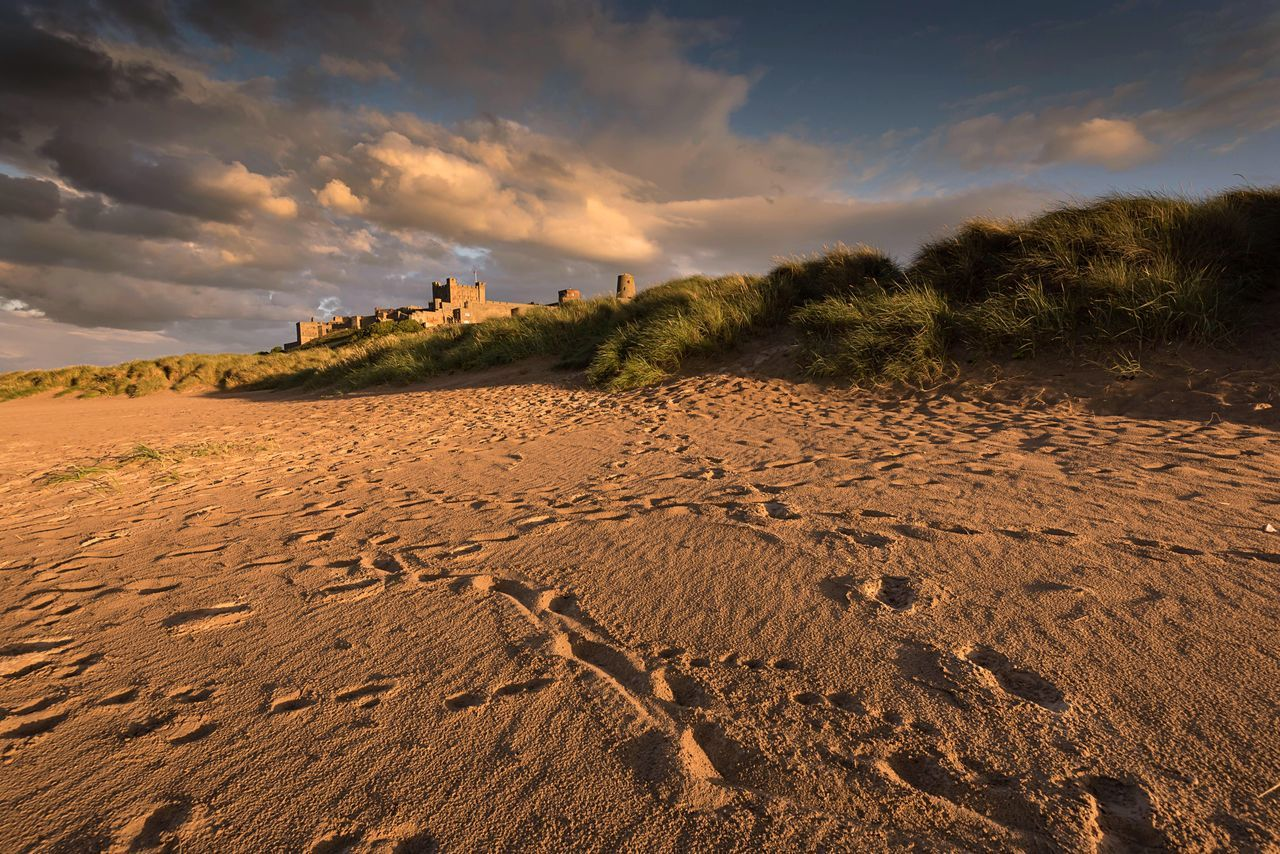 Meanderings Beach Tranquil Scene Scenics Wave Pattern Travel Destinations Bamburgh Northumberland Beach Footprints Sky And Beach Cloudporn Castle Sand Dunes Non-urban Scene Fine Art Photography Atmospheric Mood Naturelovers EyeEm Masterclass Landscape Coastal Beachphotography Beach Walk Outdoors Cloud - Sky My Favorite Place