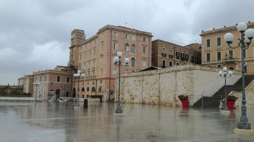 walking in the rain Sardinia Sardegna Italy  Bastione Di Saint Remy Architecture Cloud - Sky Building Exterior Built Structure History Sky Water Day Outdoors No People City