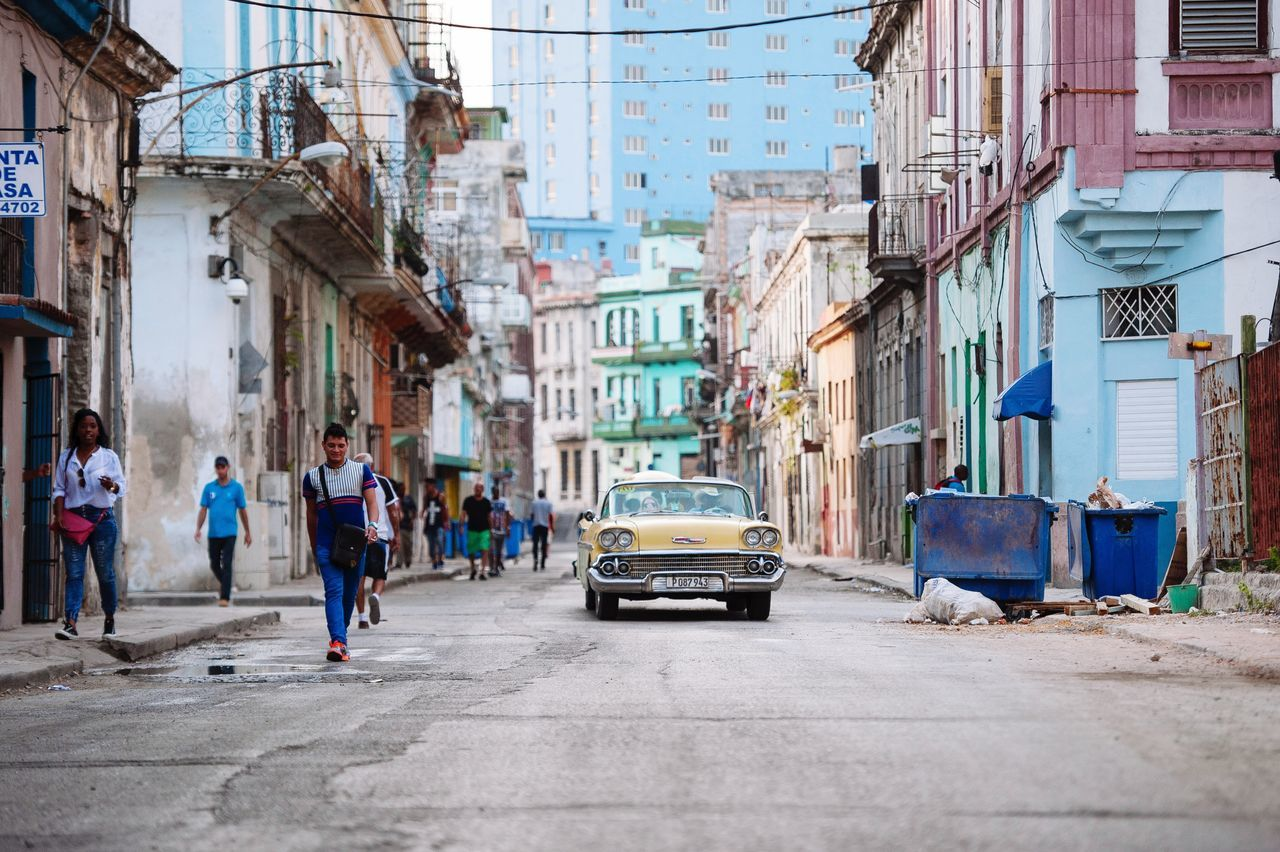 Adapted To The City I just came back home after a great trip in one of the most beautiful countries I've traveled so far: Cuba the people there are just wonderfull, friendly and above all so happy! You just have to love them. Thanks Cuba! For the great trip and the awsome pictures! City City Life Street Streetphotography Architecture Day Real People OpenEdit Nikon Eye4photography  EyeEm Best Shots EyeEm EyeEm Best Shots - People + Portrait Street Photography Cuba Collection EyeEmBestPics EyeEm Gallery City Havana Old Havana Large Group Of People Building Exterior People Miles Away Miles Away The City Light
