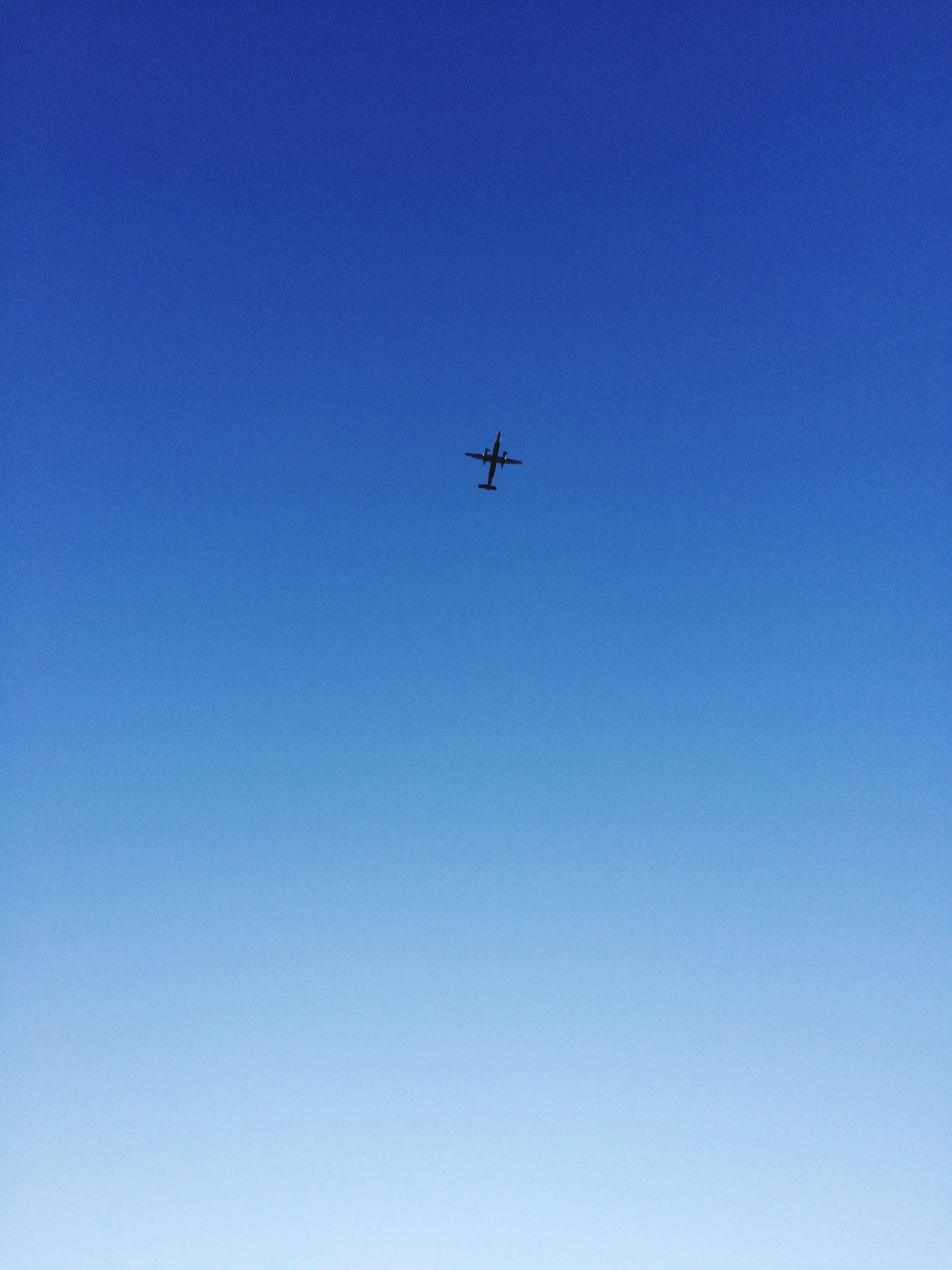 low angle view, blue, clear sky, flying, airplane, transportation, no people, outdoors, day, air vehicle, nature