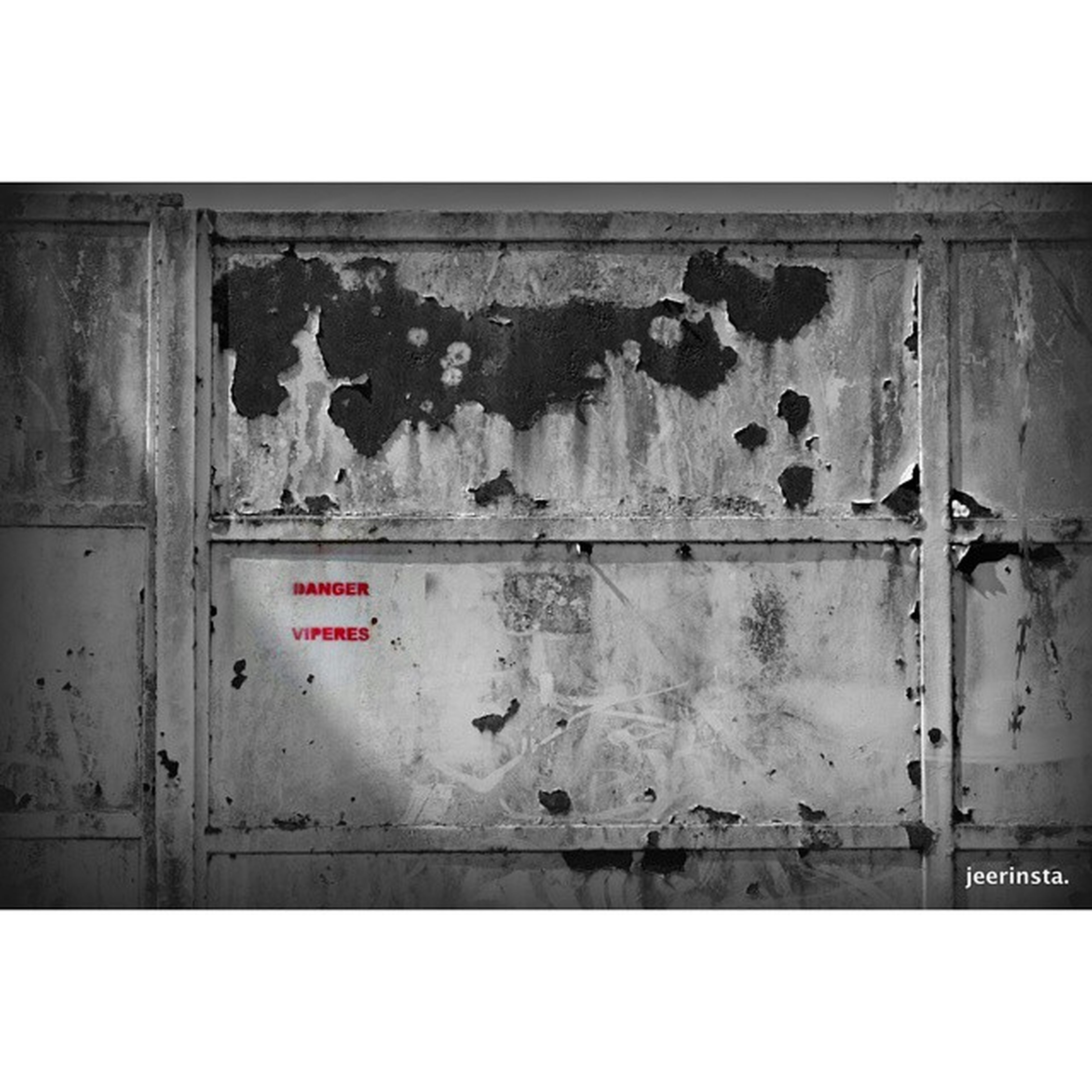 transfer print, text, architecture, built structure, wall - building feature, western script, communication, building exterior, auto post production filter, wall, weathered, door, graffiti, old, abandoned, damaged, closed, day, outdoors, capital letter
