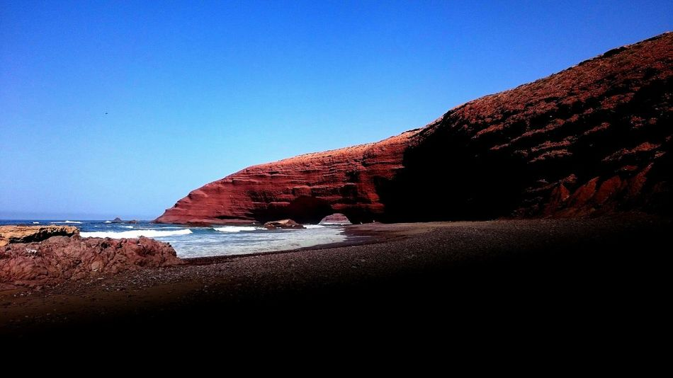 Legzira Marocco Beach Sky Sea Water Clear Sky Nature No People Streamzoofamily Streamzoo Check This Out Multi Colored Surf Swag Beauty In Nature Hello World Outdoors Vacations Enjoying Life Sun Sunset