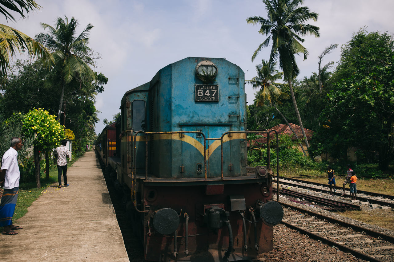 Travel in Sri Lanka Adventure ASIA Day Enjoying Life Exciting Exploration Explore Locomotive Men Mode Of Transport Public Transportation Rail Transportation Railroad Track Real People Sky South Asia Sri Lanka Sri Lankan Train - Vehicle Transportation Travel Photography Traveling Tree The Photojournalist - 2017 EyeEm Awards Let's Go. Together.