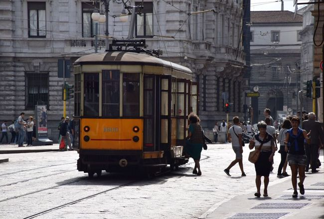 Old trams fit perfectly into Milan's historic architecture! Street Building Exterior City City Street Transportation Architecture Built Structure Mode Of Transport Cable Car City Life Travel Destinations Outdoors Land Vehicle Men Road Day Tram People Horizontal Adult