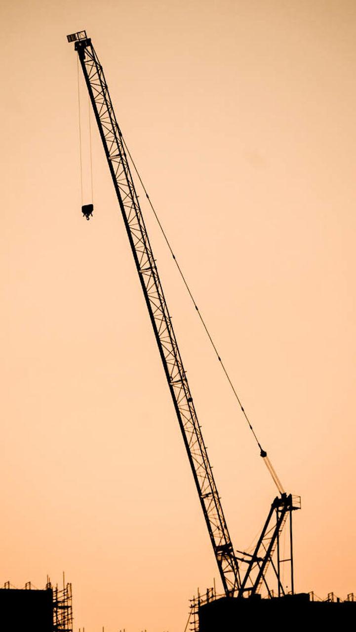 crane - construction machinery, construction site, sunset, development, silhouette, industry, construction machinery, industrial equipment, crane, outdoors, no people, freight transportation, sky, progress, architecture, modern, building exterior, city, day, shipyard