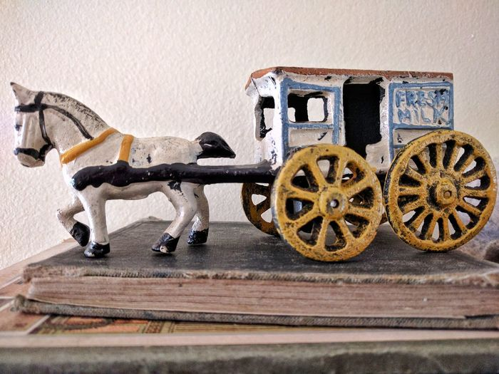 Wheel No People Indoors  Day The Past Antique Toys Antique Close Up Old Time Photos Vintage Country Life Farm Life Old-fashioned Horse With Wagon Painted Figurine Old Books Antique Books Antique Ceramic Horse With Milk Cart