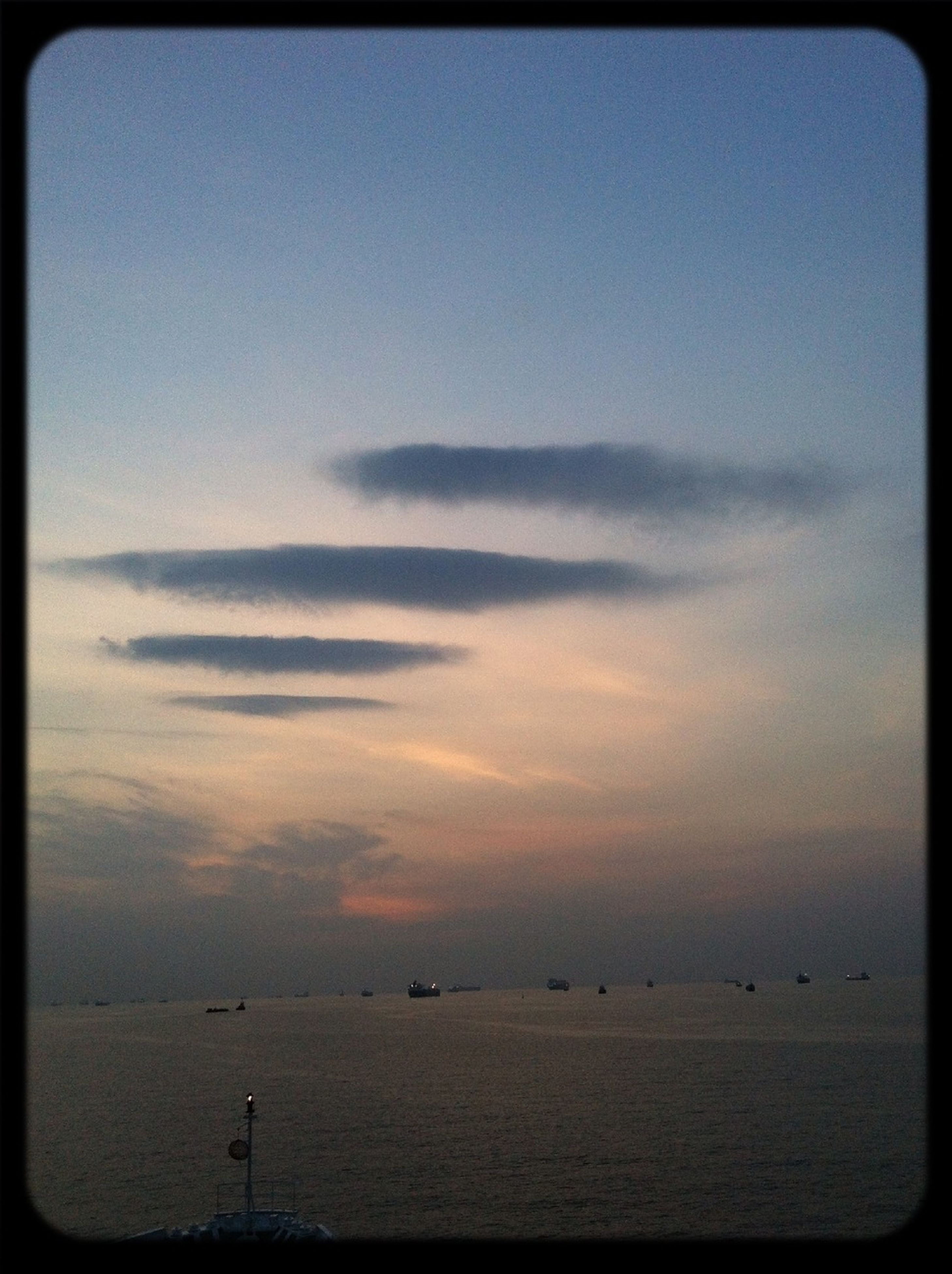 transfer print, sea, water, horizon over water, auto post production filter, tranquil scene, scenics, tranquility, beauty in nature, sky, sunset, nature, idyllic, beach, silhouette, outdoors, calm, dusk, shore, cloud - sky