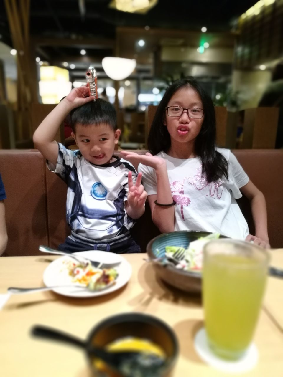 Portrait Of Sister With Brother In Restaurant