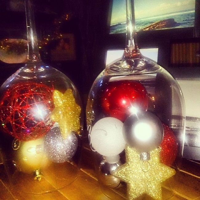 Old wine glasses filled with Xmas balls MarthaStewart Eatyourheartout