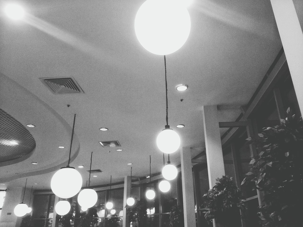 illuminated, lighting equipment, ceiling, low angle view, electric light, indoors, hanging, night, no people, light bulb, architecture