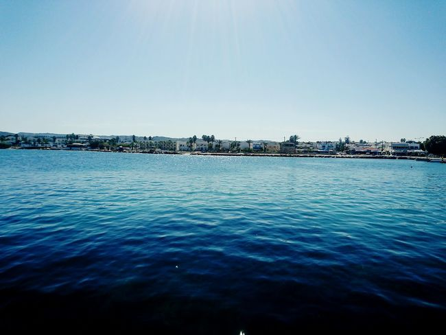 Water Tranquil Scene Tranquility Waterfront Scenics Blue Copy Space Clear Sky Beauty In Nature Sea Nature Travel Destinations Calm Non-urban Scene Water Surface Remote Day Vacations Seascape Outdoors Greek Greece Tourism Calm Harbor