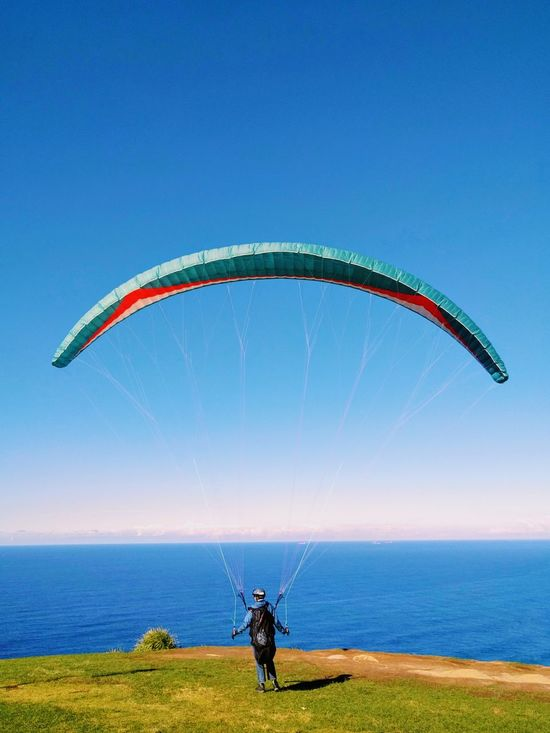 Paragliding One Person People Arms Raised Sport One Man Only Human Arm Child Adult Leisure Activity Nature Only Men Day Outdoors Vacations Standing Fun Sky Sunlight Lifestyles Men